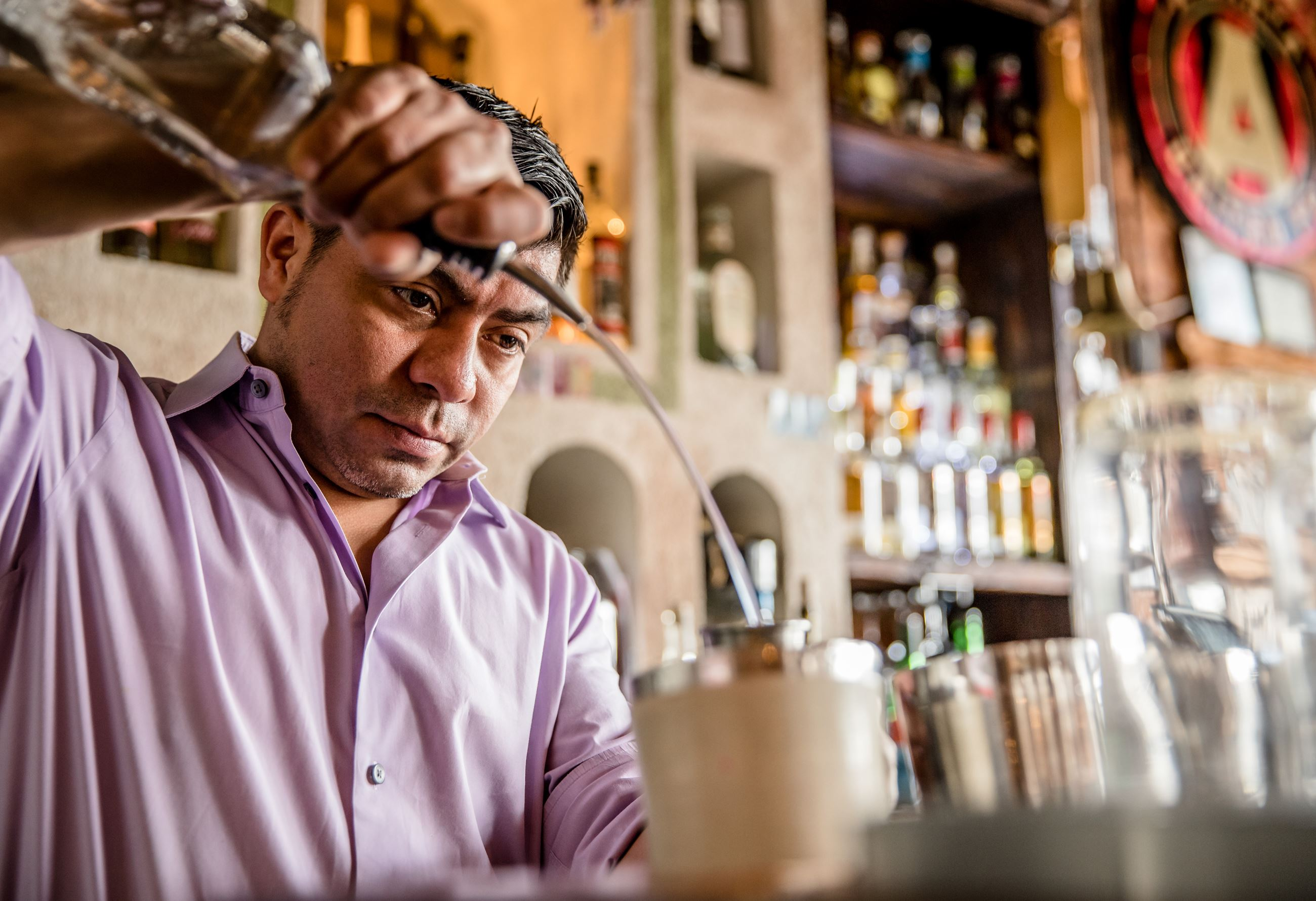 bartender in downtown norcross mixes drink
