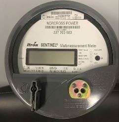 picture of the tantalus itron meter being used by Norcross Power